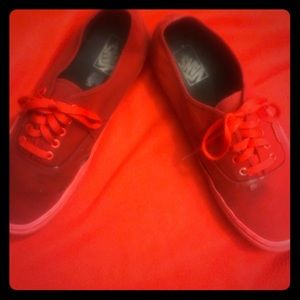 Deep red vans shoes.